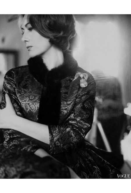 Hélène Rochas grasps her arm and looks over her shoulder. She wears a brocade dress with fur trim by Guy Laroche karen-radkai-vogue-january-1961-2