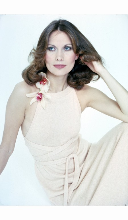 Maud Adams - Swedish models vogue in a halter-neck dress, against a white background, April 1975 ©  Susan Wood: