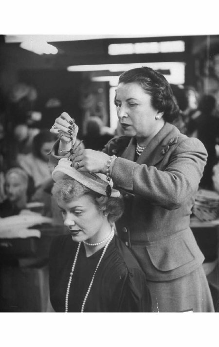 Milliner Sally Victor (R) designing a hat for actress Kyle MacDonnell. May 1948 © George Silk