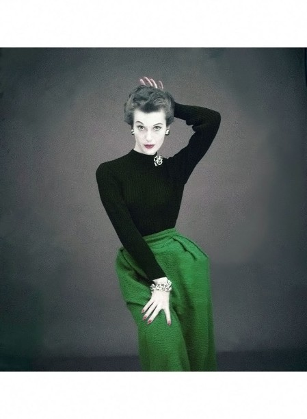 Model wearing black, knit sweater with turquoise wool, poodle cloth skirt, both by Greta Plattry Glamour 1951 © Clifford Coffin copia