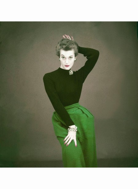 Model wearing black, knit sweater with turquoise wool, poodle cloth skirt, both by Greta Plattry Glamour 1951 © Clifford Coffin