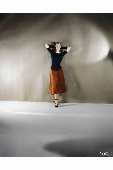 Model Wearing Burnt Umber Velvet Dress Together with Black Jersey Top from Leslie Morris oct 1946