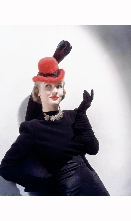 Model wearing red beaver felt hat with broad feather *** Local Caption ***