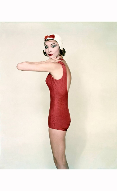 Model wearing red swimsuit by Rose Marie Reid *** Local Caption ***
