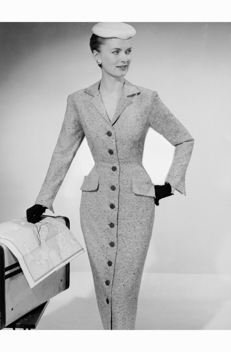Modelling a fitted Rosecroft dress with buttons down the front. april 1956 Photo by Chaloner Woods:Getty Images