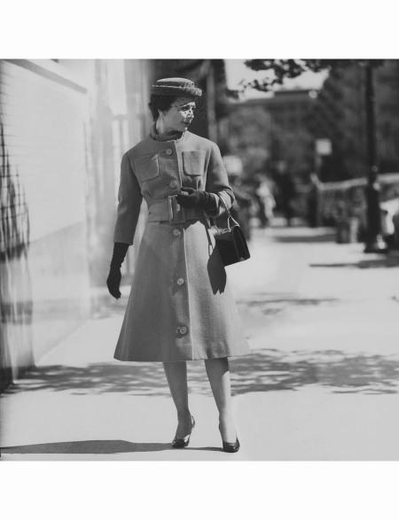 Monique de Nervo wearing wide-belted coat with veiled hat, both by Patou Nov 1958 © Karen Radkai