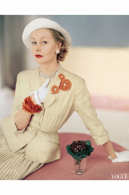 Nina De Voe Model Wearing a Silk Cream Suit