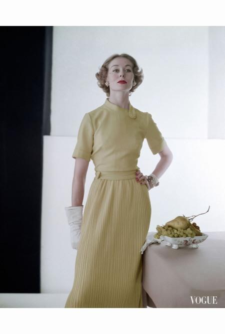 Nina De Voe Wearing Trigere Dress of Lightweight Blond Wool feb 1952