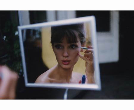 Reflection of model applying makeup in mirror Glamour july 1960 © Karen Radkai