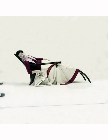 Rosalind Russell from the musical Wonderful Town wearing a silk faille dress and robe by Pierre Balmain, covered by a wool blanket with velvet borders by Dorothy Liebes 1953 Richard Rutledge