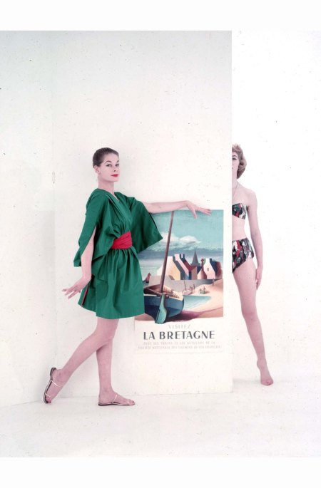 Two models add a dash of glamour to a travel poster encouraging tourists to visit 'La Bretagne 1953 © Chaloner Woods