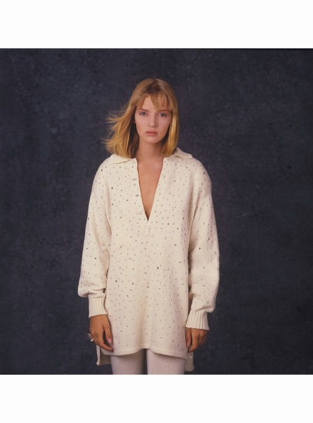 Uma Thurman as she poses in front of a blue background for an unidentified magazine photoshoot, mid 1985 © Andrea Blanch