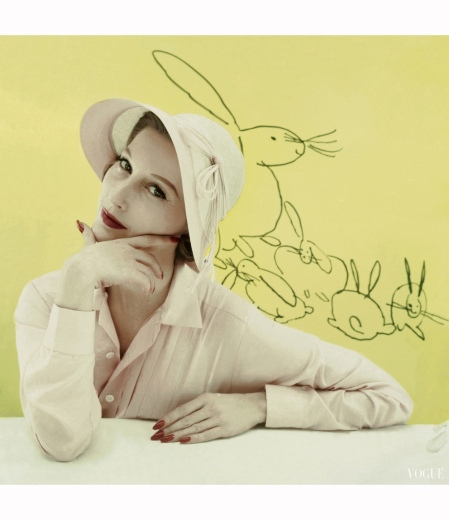 Mary Jane Russell in straw hat by John Frederics, Lady Manhattan silk shirt, rabbits drawing by Andy Warhol Glamour April 1955 © Frances McLaughlin-Gill