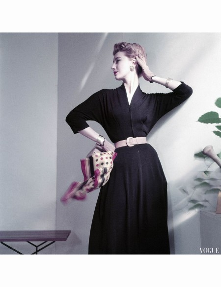 Model wearing navy-blue wool jersey shirt and skirt, blonde calf belt, and carrying multicolored scarf Vogue 1952 © Frances McLaughlin-Gill