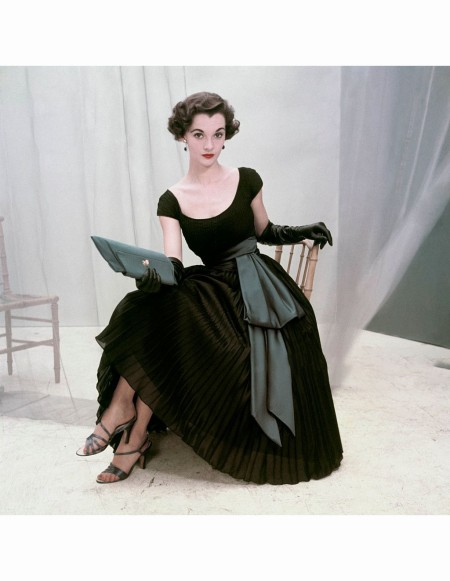Nan Rees in a billow of permanent pleats in nylon georgette, wrapped in blue satin cummerbund by Rappi Glamour 1952 © Frances McLaughlin-Gill