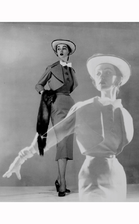 Double exposure of model wearing spring dress, hat w. veil & carrying fur scarf. 1945 Gjon Mili