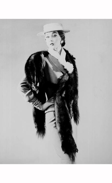 Model wearing five-skin silver fox fur piece over suit & hat w. face veil 1946 Gjon Mili