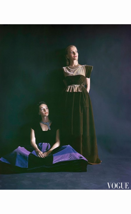 Two models wearing full-length velvet and crinoline dresses, the skirts stiffened with crinoline, both from Henri Bendel Vogue 1944