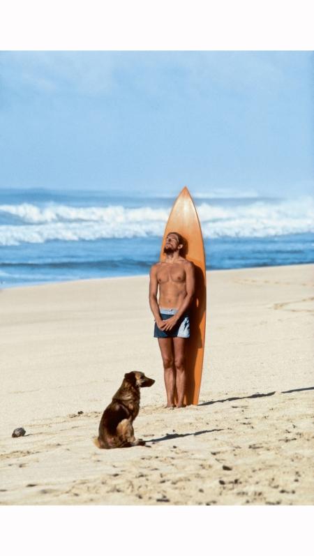 a-surfer-sunbathing-on-hawaiis-north-shore-jeff-divine