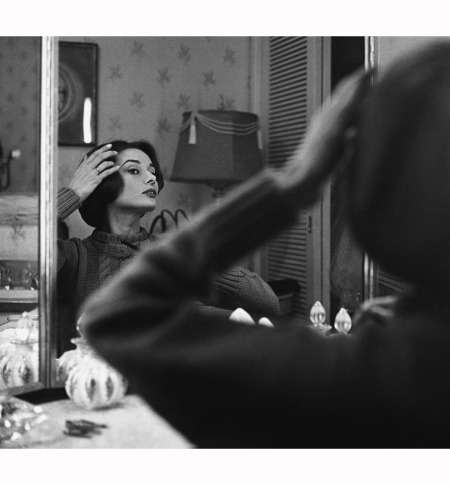 audrey-hepburn-looks-into-her-dressing-room-mirror-1957