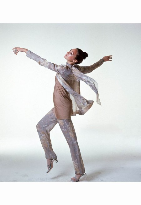 marisa-berenson-dancing-about-wearing-beige-taupe-japanese-flower-print-chiffon-cardigan-pant-and-muffler-by-chester-weinberg-bonnie-doon-tights-celia-sebiri-rings-and-sandals-with-heels-by-jul