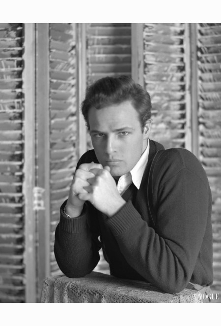 marlon-brando-wearing-a-sweater-and-button-down-shirt-leaning-on-his-elbows-vogue-feb-1948-serge-balkin-b