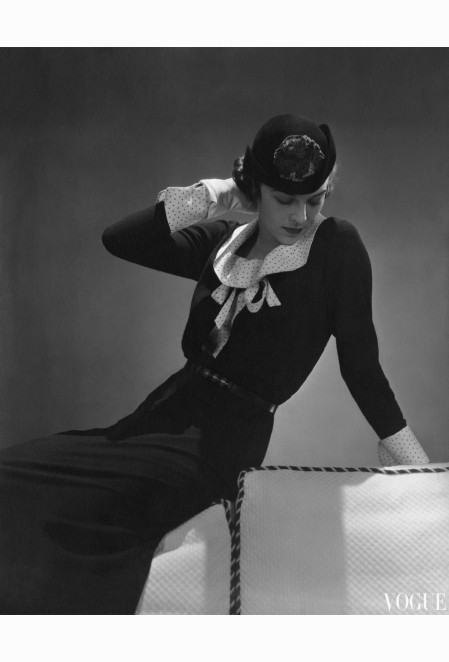 model-anne-whitehead-wearing-dark-wool-dress-with-a-pique-collar-and-cuffs-and-a-dark-hat-vogue-jan-1935-lusha-nelson