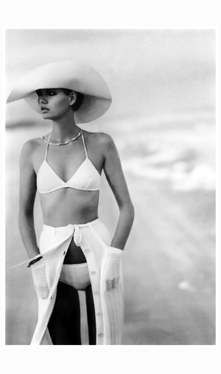 model-at-the-amelia-island-plantation-in-florida-wearing-a-white-knit-bikini-with-zig-zag-pattern-with-halter-top-and-small-bottom-under-matching-button-front-skirt-with-tie-waist-by-missoni-and-s