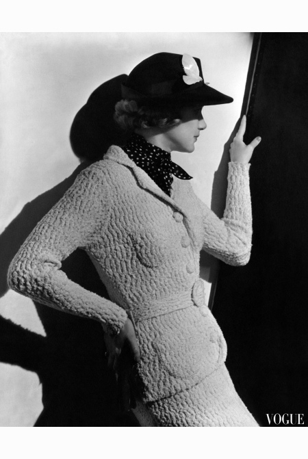 model-gretchen-uppercue-wearing-a-knit-suit-of-biscuit-cotton-chenille-and-a-felt-hat-with-a-shadowing-brim-and-a-shell-ornament-vogue-april-1936-lusha-nelson