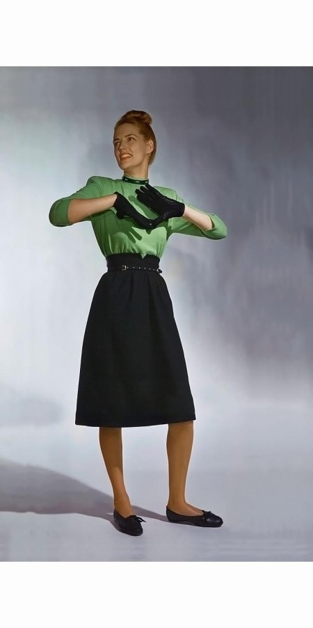 model-in-green-turtleneck-wool-jersey-blouse-with-a-dirndl-front-black-wool-skirt-both-by-majestic-serge-balkin