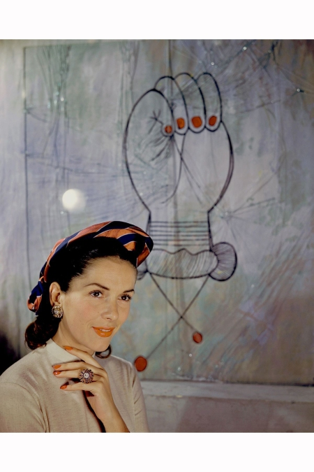 model-jinx-faulkenburg-wears-a-hat-by-suzanne-talbot-next-to-a-picasso-print-1946