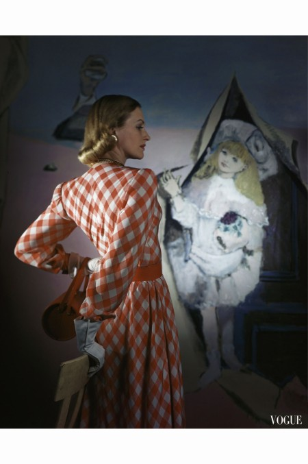model-standing-before-a-mural-by-vertes-wearing-a-red-and-white-lattice-checked-rayon-crepe-dress-april-1946