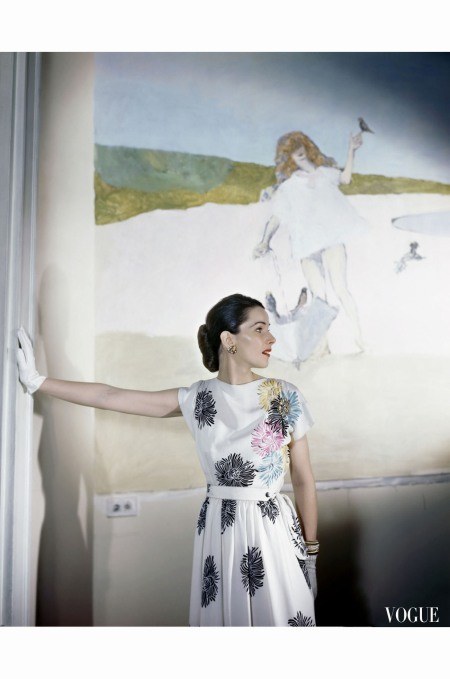 model-standing-before-mural-by-vertes-wearing-floral-print-on-white-rayon-crepe-dress-april-1946