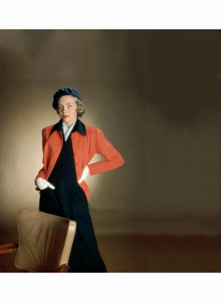 model-wearing-deep-throated-two-piece-dress-in-navy-with-straight-little-cardigan-jacket-in-red-glamour-1949-serge-balkin-copia