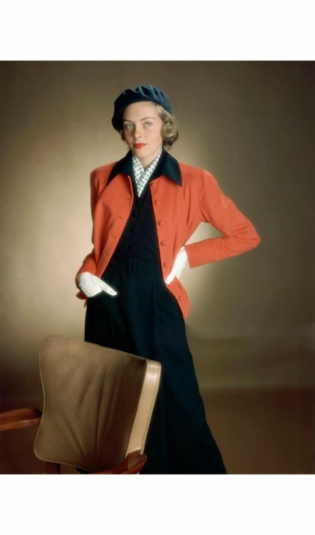 model-wearing-deep-throated-two-piece-dress-in-navy-with-straight-little-cardigan-jacket-in-red-glamour-1949-serge-balkin