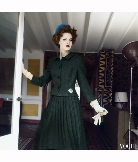 model-wearing-green-wool-tweed-suit-short-fitted-jacket-with-long-pleated-skirt-accented-by-bright-blue-velvet-pillbox-hat-vogue-1959