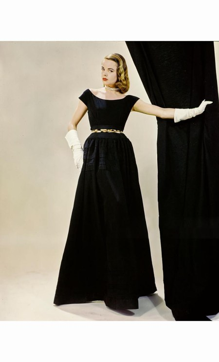 model-wearing-short-sleeved-full-length-black-dress-with-leopard-belt-from-ceil-chapman-erwin-blumenfeld