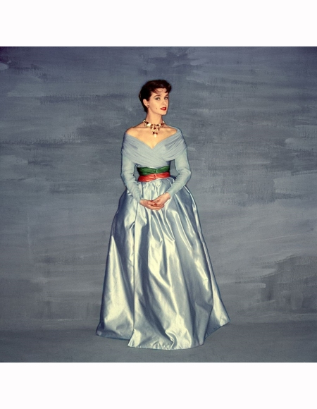 model-wearing-silvery-blue-evening-dress-double-chiffon-top-over-full-satin-skirt-pulled-together-at-waist-by-sashes-of-green-and-orange-clifford-coffin