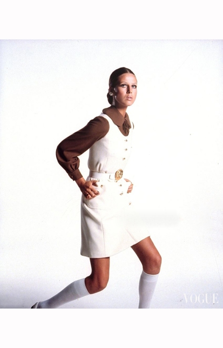 model-wearing-white-patch-pocket-jumper-over-brown-crepe-shirt-by-seymour-fox-with-bergere-earrings-gautier-buckle-trifari-rings-and-bonnie-doon-knee-shots-hair-by-hugh-harrison-vogue-1969-b