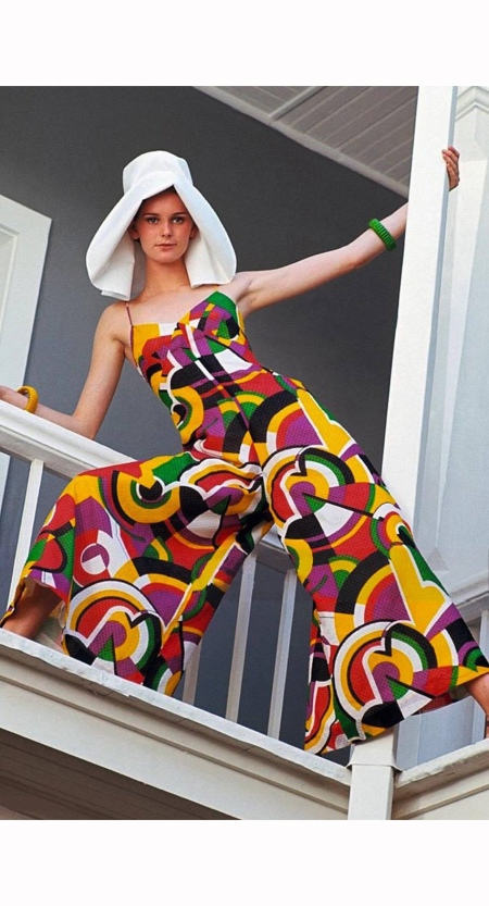model-wears-a-flare-legged-jumped-suit-redgreenyellowpurple-geometric-print-by-frank-smith-for-saks-fifth-avenue-bracelets-by-hattie-carnegie-mademoiselle-1967-george-barkentin