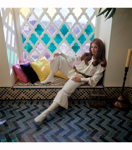 mrs-paul-getty-jr-wearing-white-outfit-and-boots-sitting-in-windowseat-next-to-stained-glass-window-in-their-marrakesh-home-vogue-1970-patrick-lichfield