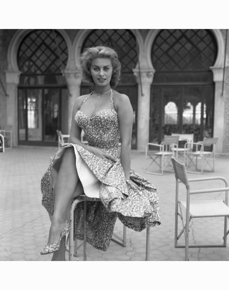 sophia-loren-sitting-on-a-chair-wearing-a-floral-dress-venice-1955-photo-by-archivio-cameraphoto-epochegetty-images