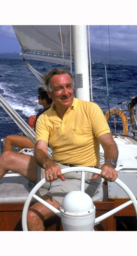tv-newsanchor-walter-cronkite-at-wheel-of-boat