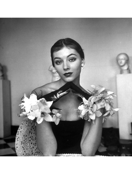 a-model-wearing-a-flowery-glove-while-peering-into-the-distance-1951