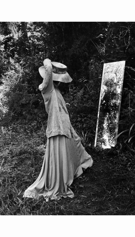 actress-katharine-hepburn-in-costume-adjusting-her-hat-in-a-mirror-in-the-jungle-on-location-to-film-her-motion-picture-%22the-african-queen-1951