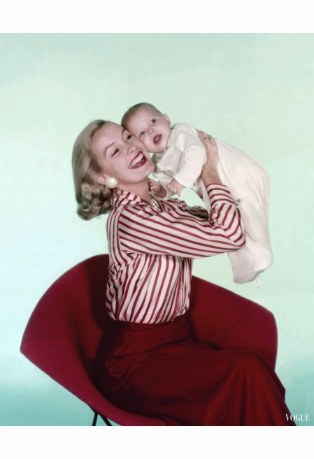 dina-merrill-wearing-a-red-striped-silk-shirt-and-a-slim-fit-ankle-length-red-wool-skirt-both-by-sportwhirl-cover-photo-by-john-rawlings-vogue-december-1956-john-rawlings-vogue-december-1956