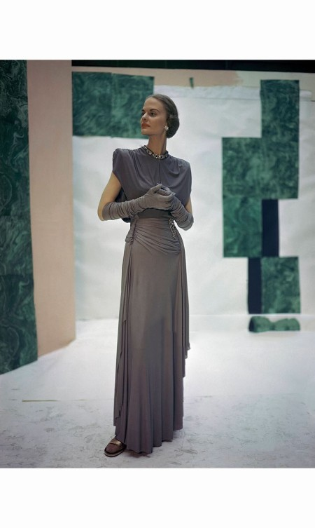 dorothy-tivis-wearing-steel-blue-draped-rayon-dinner-dress-from-trigere-vogue-1946-john-rawlings