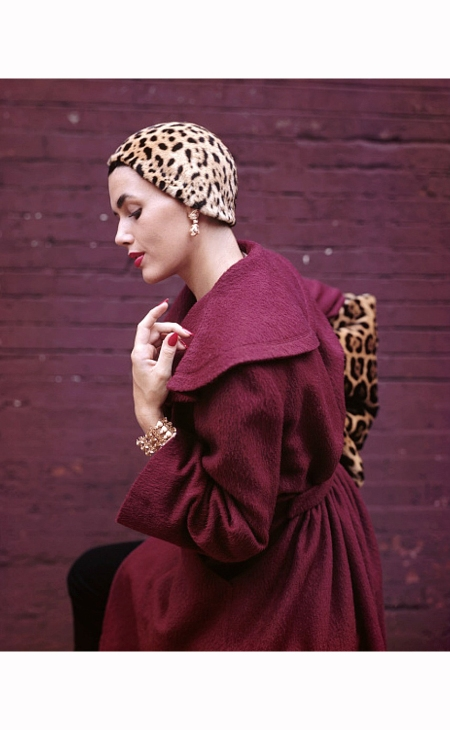 Model Wearing Plum Jacket and Jaguar Hat