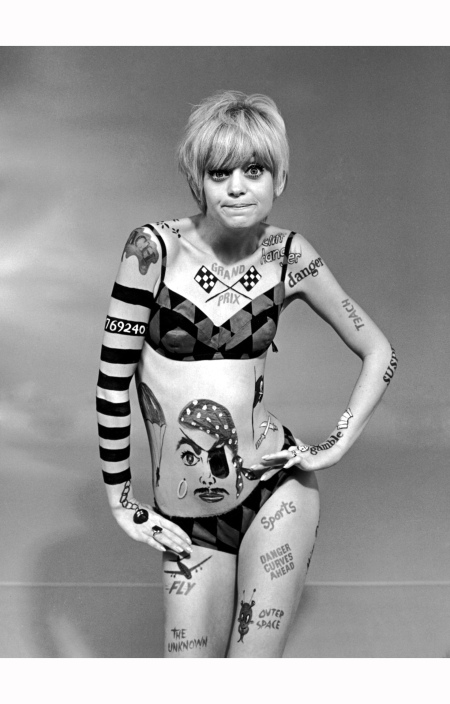 1968: American actor Goldie Hawn wears body paint and a bikini in a promotional portrait for the television series, 'Laugh-In'.