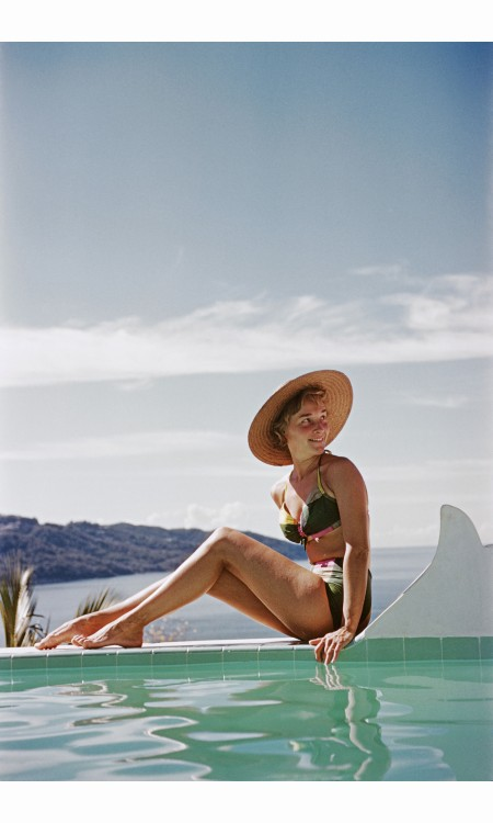 ingrid-morath-sunbathes-by-a-swimming-pool-next-to-the-sea-in-acapulco-january-1961-ingrid-was-born-in-rio-de-janeiro-and-lives-in-mexico-city-inge-morath-acapulco-1961
